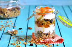 Layered dessert from granola,yogurt,persimmon and honey. Royalty Free Stock Photography
