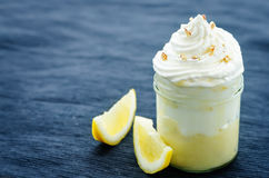 Layered dessert with lemon cream, ice cream and whipped cream Royalty Free Stock Photos