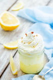 Layered dessert with lemon cream, ice cream and whipped cream. Tinting. selective focus Stock Photography