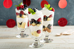 Layered dessert parfait with sweet bread and berries. Layered dessert parfait with sweet bread, whipped cream and berries Stock Images
