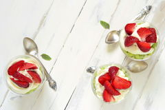 Layered dessert with strawberries, kiwi, biscuit and cream, Trifle Royalty Free Stock Images
