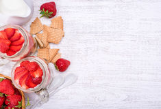 Layered dessert with strawberry and cream cheese in glass jar. Stock Images