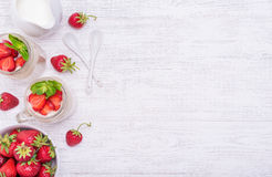 Layered dessert with strawberry and cream cheese in glass jar. Royalty Free Stock Photos