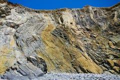 Layered and folded rock Stock Photo