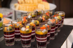 Layered fruit jelly made from wild strawberries, blueberries an Royalty Free Stock Photo
