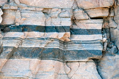 Layered gneiss rock Stock Photo