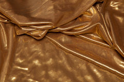 Layered gold fabric background Stock Photography