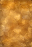 Layered golden background. A golden glittering background of layered transparent oval shapes in warm yellow tones Royalty Free Stock Images