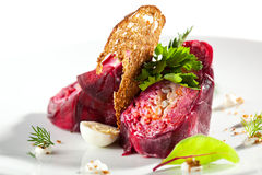 Layered Herring Salad. Traditional Russian Herring and Beet Salad with Crisp Bread Stock Image