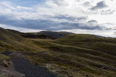 Green hills of Reykjadalur. Layered hills on our way back from hot springs bath Royalty Free Stock Images