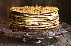 Layered honey cake with custard. Royalty Free Stock Image