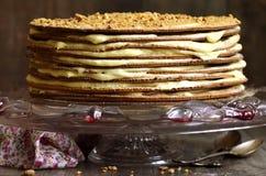 Layered honey cake with custard. Royalty Free Stock Photo