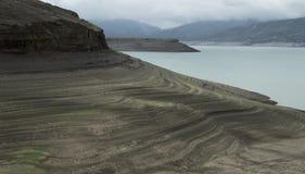 Layered lake shore after draining stock image