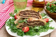 Layered Meat Pies With Green Salad Royalty Free Stock Image