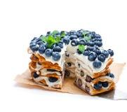 Layered pancakes with mascarpone cream and blueberry stock photos