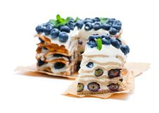 Layered pancakes with mascarpone cream and blueberry royalty free stock photography