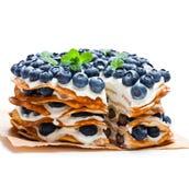 Layered pancakes with mascarpone cream and blueberry stock photography