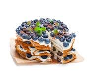 Layered pancakes with mascarpone cream and blueberry royalty free stock photos