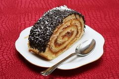 Layered Pastry. A piece of a cake (called trunk) with layers of marmalade inside, and truffle on the top royalty free stock image