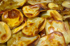 Layered Potatoes. Baked with a golden glaze close up with a shallow depth of field Stock Images