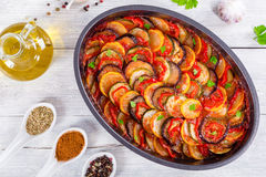 Layered ratatouille in a baking dish, top view stock photos