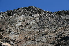 Layered rock. Conglomerate rock at the foot Mutnovsky volcano Royalty Free Stock Image