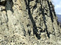 Layered rocks on the slopes of the Georgian military road. In Georgia stock photos