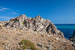 Layered rocks on the southern coast of Crete. Royalty Free Stock Image