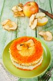 Layered salad with carrots, egg, cheese and apple royalty free stock images