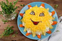 Layered salad in the form of Sun royalty free stock photo