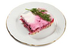Layered salad of herring, potatoes, beet Royalty Free Stock Images
