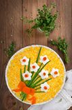 Layered salad with spring decoration Daffodil stock photography