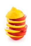 Layered slices of yellow lemon and red tomato. Stacked in a tower on a white background Stock Photos