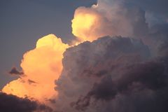 Layered sunlit thunderhead storm clouds royalty free stock image