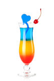Layered tropical cocktail with blue heart decorati Stock Image