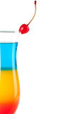 Layered tropical cocktail with maraschino Royalty Free Stock Photography