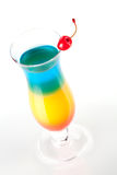 Layered tropical cocktail with maraschino Royalty Free Stock Photos