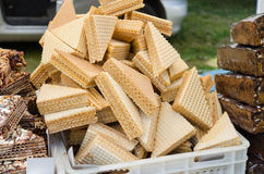 Layered vanilla wafer pile on stall outdoor market Stock Photos