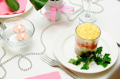 Layered vegetable salad. On the festive table Royalty Free Stock Photos
