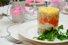 Layered vegetable salad. On the festive table Royalty Free Stock Photography