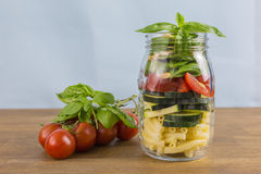 Layered vegetable salad with pasta Royalty Free Stock Images