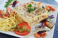 Tomato pasta with fresh garnish Royalty Free Stock Photos