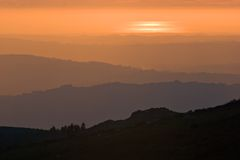 Layers. View over layered mountains on a beautiful Sunset Stock Image