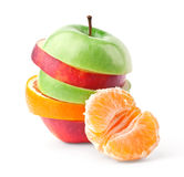 Layers of apples and oranges with tangerine slice. Layers of apples and oranges with slice of tangerine isolated on white background stock photography