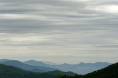 Layers of Clouds and Mountains Stock Images