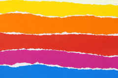 Layers of colorful torn papers stock photo