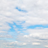 Layers of cumulus clouds in blue autumn sky Royalty Free Stock Photo