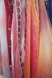Layers of fabric.. Soft folds of layers of fabric streaming downwards.  Bright pink and orange colours Stock Photography