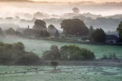 Layers of fog over Autumn agricultural landscape Stock Photos