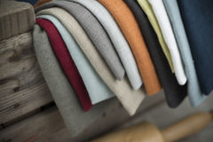 Layers of Folded Cotton Fabric Hanging on Crate Royalty Free Stock Photography